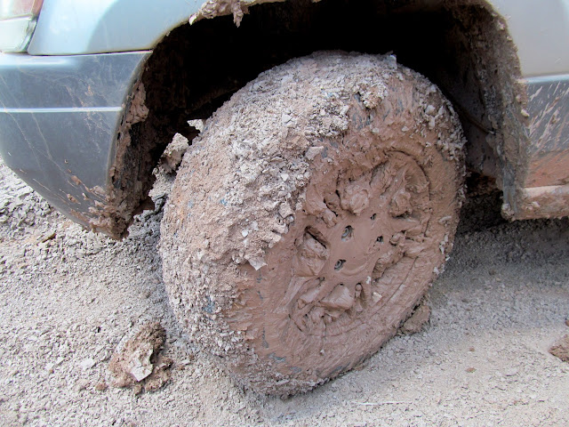 Mud-caked wheel and tire