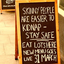 Photo: Sign outside of a pub in London
