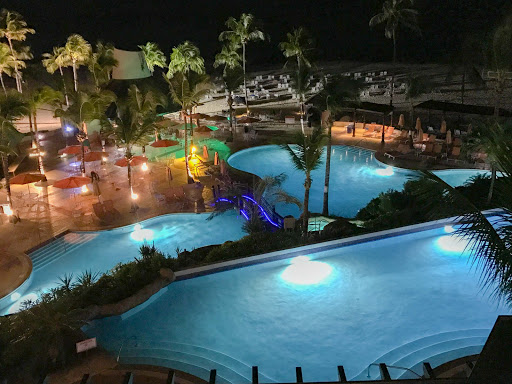 Hilton-Barbados-pool-at-night.jpg - The illuminated pool of the Hilton Barbados Resort at night.