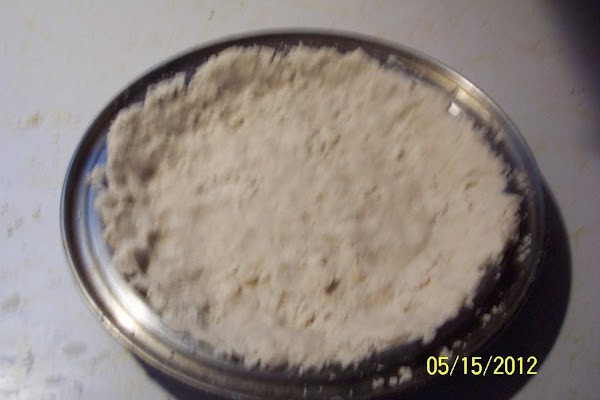 To prepare filling: Combine cut up rhubarb with sugar and flour. Spoon into pie crust Dot with...