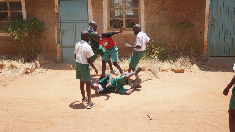 Mwingi Primary school pupils playing football on October 12 during initial reopening..