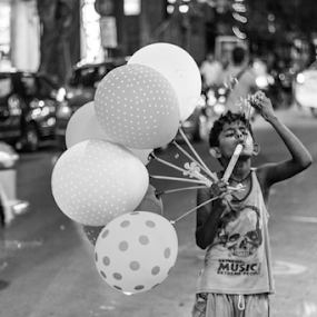 Little dream seller by Subhajit Basak - City,  Street & Park  Street Scenes ( monochrome, black and white, kolkata, streetscape, street, bubbles, candid, street scene, balloon, people, bengal, portrait, street photography, street life, india, bengali, street photo, street scenes, boy )