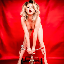 A Girl and Her Toy by Brian Brown - Nudes & Boudoir Artistic Nude ( toes, cute, babe, curves, sexy, blonde, girl, red, bike, toy, color, curls, lips, heels, fetish )