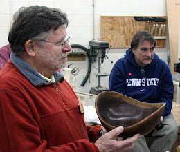 Photo: Richard Webster displays his NE walnut bowl accented with a touch of turquoise.