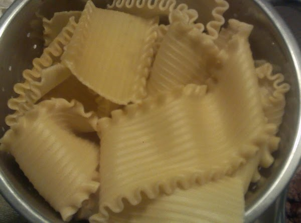 Cook the box of Lasagna noodles according to package directions.  Drain & rinse...