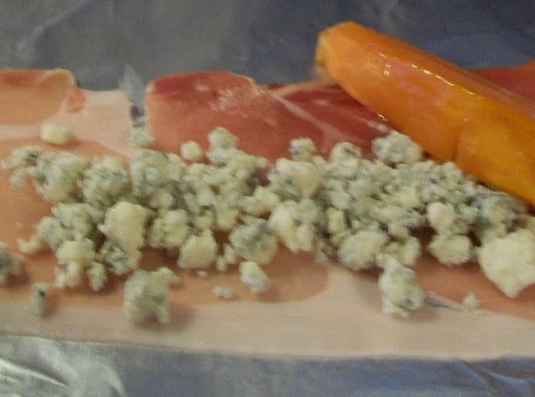 Lay out the Prosciutto, and add a sweet potato finger, and add the blue...