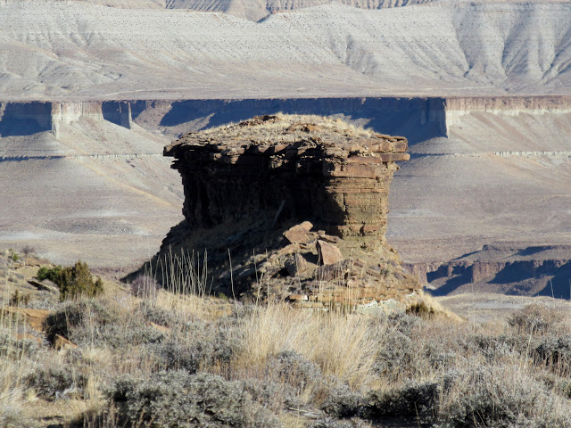 Inaccessible butte with ruins on top