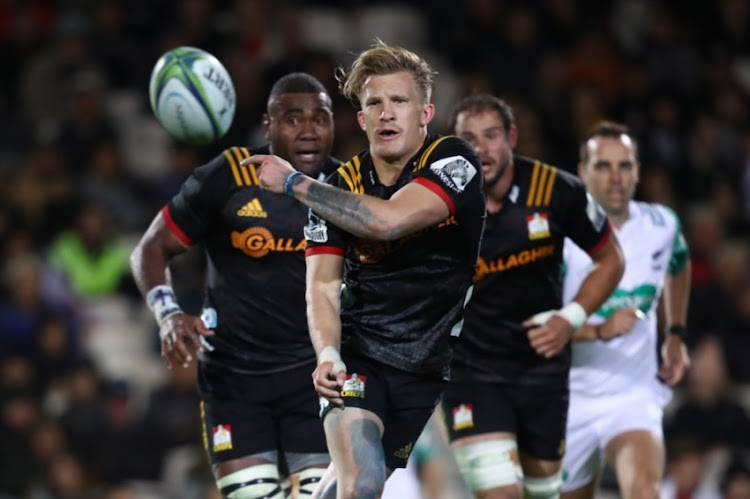 Damian McKenzie of the Chiefs passes during the round 12 Super Rugby match between the Chiefs and the Jaguares at Rotorua International Stadium on May 4, 2018 in Rotorua, New Zealand.