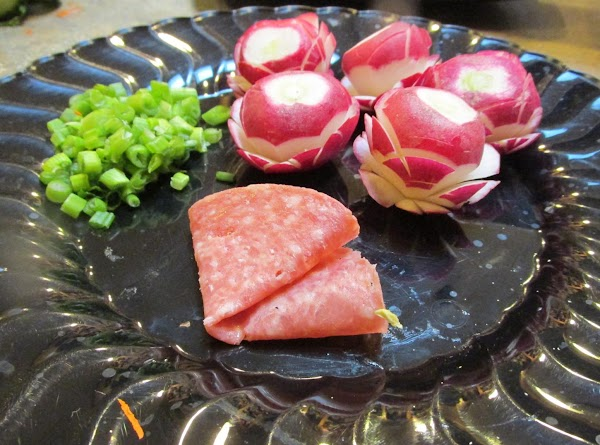 To make the Chicken or Salami flower in the center of the salad. (YOU...