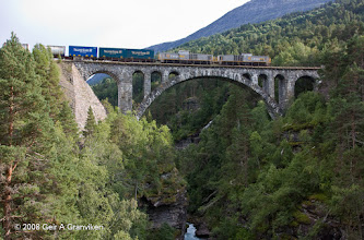 Photo: CargoNet freight train, pulled by two Di8 diesel electric locomotives, on Kylling bridge on the Rauma line towards Åndalsnes