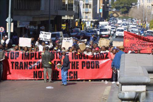 FLASHBACK: SAMWU members march in Johannesburg. 28/03/07.  South African Municipal Workers Union (SAMU) members march in downtown Johannesburg as part of a  national strike over a pay rise dispute. As a mark of protest they systematically trash the city. 5/7/02.  Pic. by Sydney Seshibedi. © ST.