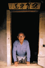 Photo: Scholar and calligrapher in his home.