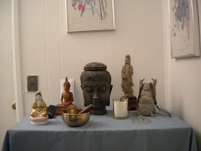Photo: The Shakyamuni Buddha statue and his friends in our basement meditation room.