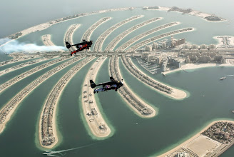 Photo: An aerial view taken from a sea plane shows Swiss pilot and original Jetman Yves Rossy (front) and Vince Reffett flying over Dubai's Palm Island, Dubai, United Arab Emirates May 12, 2015. REUTERS/Lara Sukhtian       TPX IMAGES OF THE DAY