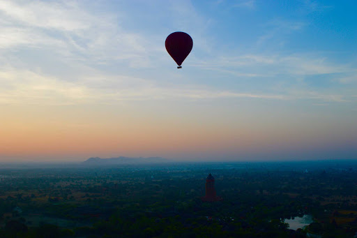 over-bagan-at-daybreak - We rose before daylight, and with some trepidation, joined others (16 people per balloon) in baskets below one of 10 balloons, and floated over the city and countryside as the sun rose.