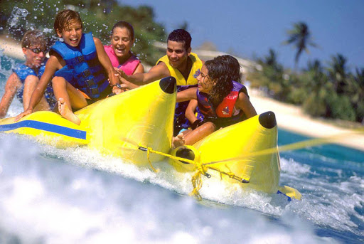 A family banana boat ride in Aruba. Plan your own outing and save some money.
