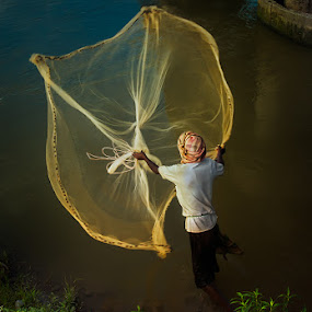 Fishing  by Subrata Kar - Professional People Agricultural Workers ( water, fisher men, fish, net, evening )