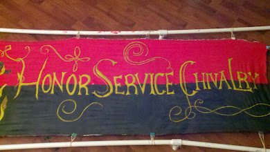 Photo: Completed banner with period sizing and period technique, using modern dyes for durability. Barony of Darkwater motto with knight design taken from an extant banner. Motto detail.