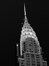 "Photo: ""Touching the sky...""   If you are fortunate enough to look up at exactly the right time, you can catch the sun dancing along the top of the Chrysler Building.  As the sun glides across the iconic spire, it leaves glimmering trails: shimmering footsteps connecting the sky to the city.  The Chrysler Building is a classic example of Art Deco architecture. Designed by architect William Van Alen for a project of Walter P. Chrysler, it was the headquarters of the Chrysler Corporation from 1930 until the mid 1950's. Even though the building was built and designed specifically for the car manufacturer, the corporation did not pay for the construction of it and never owned it, as Walter P. Chrysler decided to pay for it himself, so that his children could inherit it.  Upon its completion on May 20, 1930, the added height of the spire allowed the Chrysler Building to surpass 40 Wall Street as the tallest building in the world and the Eiffel Tower as the tallest structure. It was the first man-made structure to stand taller than 1,000 feet.    New York Photography - The Chrysler Building.    You can view this post along with information about purchasing prints of this image if you wish at my site here:  http://nythroughthelens.com/post/22197095943/the-chrysler-building-midtown-new-york-city  -  Tags: #photography #nyc #newyorkcity #architecture #skyscraper #blackandwhite #blackandwhitenewyorkcityphotography #newyorkcityphotography #manhattan"