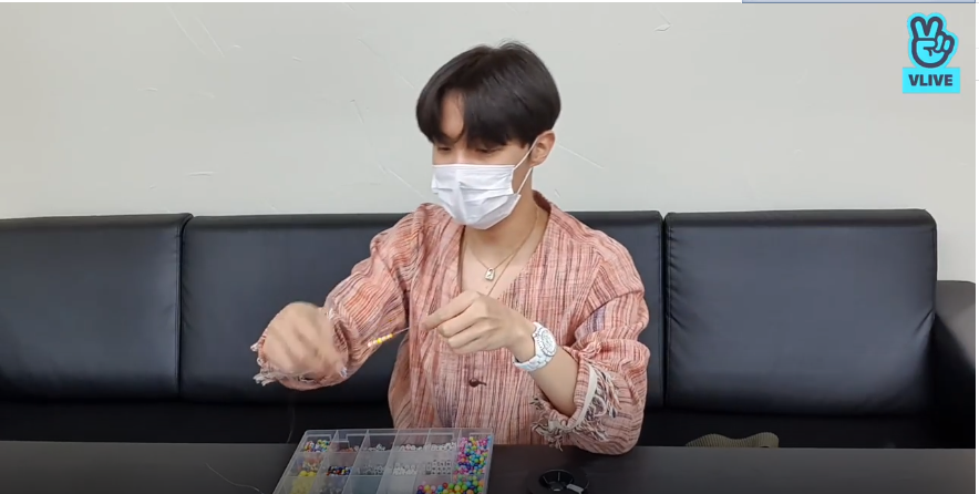 Hobi making bracelet for BTS