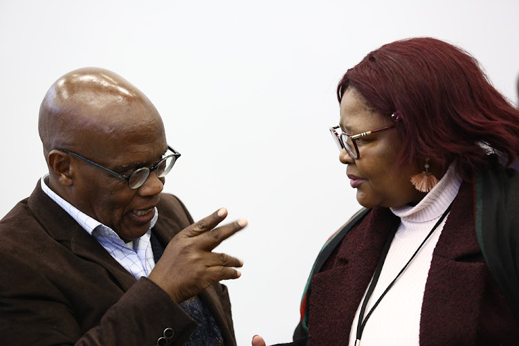 Mothobi Mutloatse and former ANC MP Vytjie Mentor chat at the Zondo commission of inquiry into state capture in Parktown, Johannesburg, on August 28 2018.