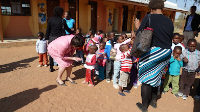Photo: PC Botswana Program Director Heather Robinson with a child from the home-based care center