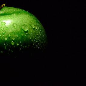 half of life by Pete G. Flores - Food & Drink Fruits & Vegetables ( studio, water, green, pwcfruit, drop, food, light )