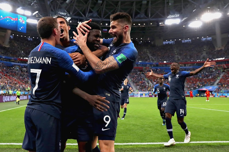 amuel Umtiti of France is mobbed by his team after scoring his sides first goal during the 2018 FIFA World Cup Russia Semi Final match between Belgium and France at Saint Petersburg Stadium on July 10, 2018 in Saint Petersburg, Russia.