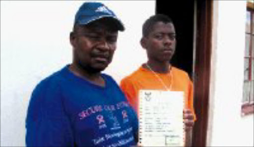 NOT FUNNY: Peter and Motsumi Shumba display the death certificate that was issued instead of an identity document. © Sowetan.