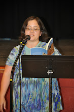 """Photo: Ana Christensen reads her contribution to the """"Everywhere"""" section of the RASP poetry anthology."""