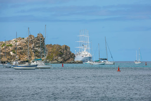 st-barts-wind-surf-harbor.jpg - Wind Surf peeks out from behind a rock outcropping in Gustavia Habour.