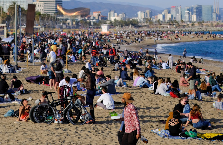 People spend time at Barceloneta beach, amid the coronavirus disease (Covid-19) outbreak, in Barcelona, Spain on April 2, 2021.