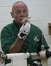 Photo: With the form taking shape on the lathe, Patrick reminds us of the goals.