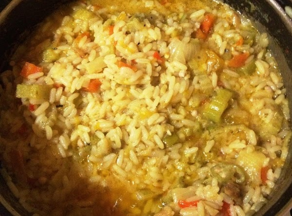 In a sauce pan saute onions, garlic, ginger, peppers,lemongrass,carrots, pumpkin and ochros. Until slightly tender,...