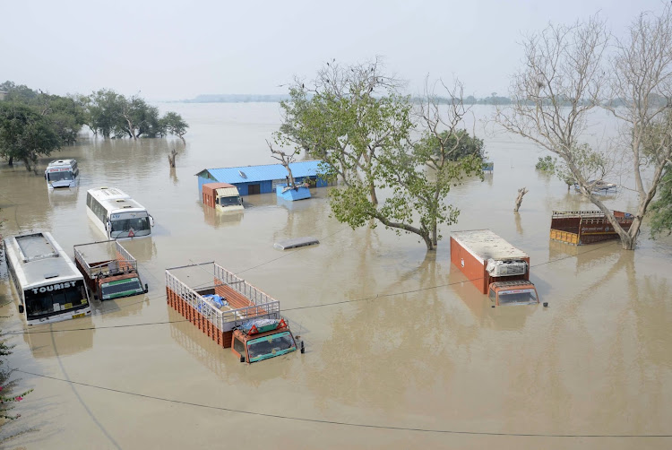 Vehicles are submerged in the rising waters of river Yamuna in New Delh. Picture: REUTERS