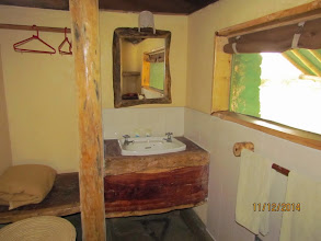 Photo: Wash basin and hanging area - not sure of the need for an extra blanket!