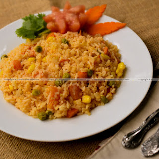 Mexican Rice With Corn And Peas.