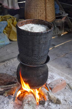 Photo: Common way of cooking sticky rice - main staple for Lao. The locals consume this for nearly all meals, including breakfast.