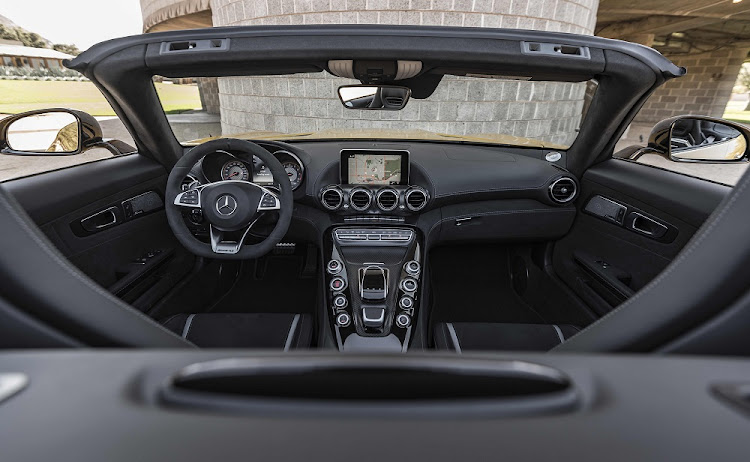 While the focus in on the steering wheel, that fighter jet style centre console is a strong design detail.    Picture: DAIMLER