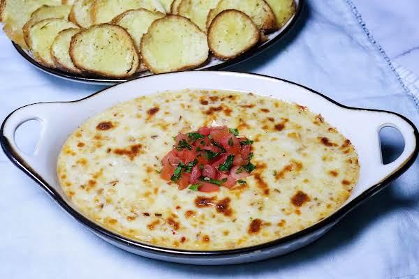 Smoked Mozzarella Fonduta With Diced Tomatoes On Top.