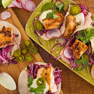 Chipotle Grilled Fish Tacos with Tequila-Lime Slaw and Avocado Crema.