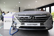The Hyundai Motor Co. next generation fuel-cell electric SUV provides electricity to external equipment during an unveiling event in Seoul, South Korea, on August 17, 2017. Hyundai says electric vehicles will underpin its push into environmentally friendly cars.