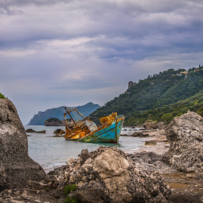 The abandoned shipwreck by Nikos Diavatis - Landscapes Mountains & Hills ( cloud formations, clouds, chip, wreck, rock formation, seascape, abandoned )