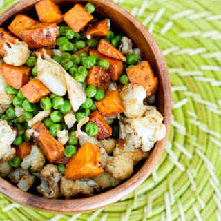 Indian-Spiced Roasted Cauliflower, Sweet Potatoes, and Green Peas.