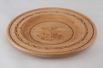 "Photo: Margaret Follas 7"" x 1"" plate [basswood] - with chip carving"