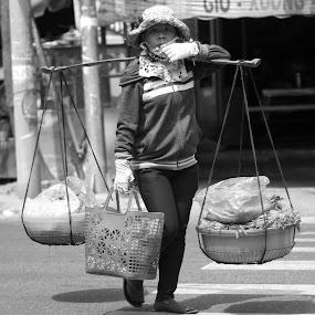 Street vendor by Henry Nguyen - People Street & Candids