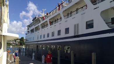 Photo: a big cruise ship trying to tie up on a small dock. Not a good recipe for success.