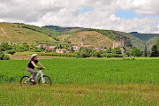 Cycling outside Châteaubourg, France, on the banks of the Rhône River.