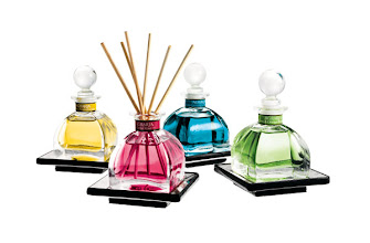 Photo: AGRARIA Exclusively ours. Santa Barbara PetiteEssenceTM Collection. Includes Golden Pomegranate, the new Cedar Rose, Mediterranean Jasmine and Lime & Orange Blossoms fragrances. 1.7 oz. each. Gift box includes decorative trays and reeds. $95. USA. Seventh Floor. 212 872 2686
