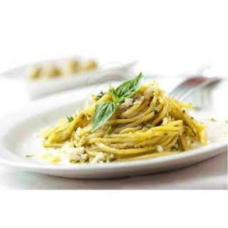 Spaghetti With Fresh Basil & Oregano In A Garlic White Wine Reduction.
